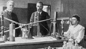 ilustracja marii curie-sklodowskiej z mezem w laboratorium